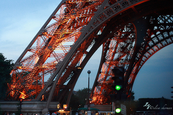 Paris at night, base of the Eiffel Tower ~ France (Elisa Sherman)