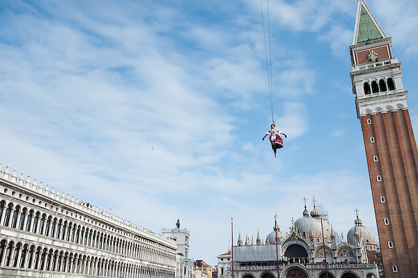 A Venetian girl performs as 'Colombina' during the Volo dell'Angelo, as she flies down from San Marco Tower to the square during the official opening of Venice Carnival (Marco Secchi)