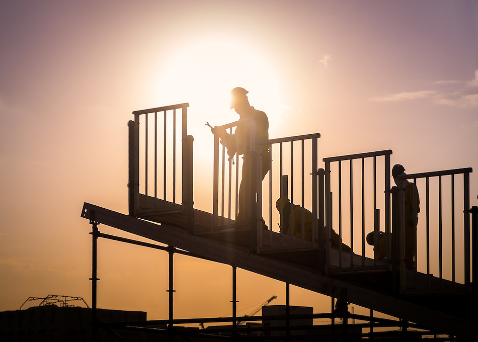 DOHA, QATAR - CIRCA DECEMBER 2013: Construction workers preparing a grandstand before a national celebration in Doha. (Daniel Korzeniewski)