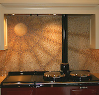 Custom kitchen sunburst stove backsplash in red and gold hand chopped 1cm marble tesserae. (New Ravenna Mosaics 2004)