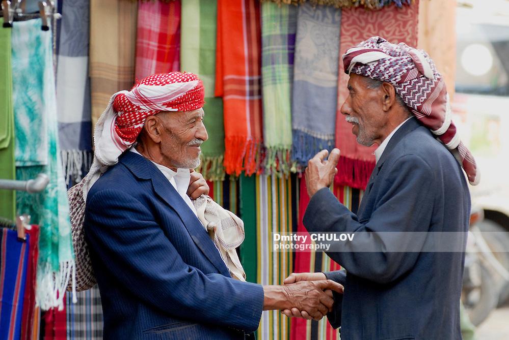 SANA'A, YEMEN - SEPTEMBER 18, 2006: Two unidentified men shake hands at the market in Sana'a, Yemen. (Dmitry Chulov)