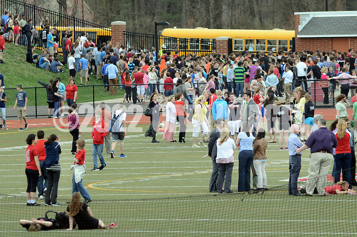 SOUDERTON, PA - APRIL 14:  Students waits on the football field after a bomb threat forced the evacuation of Souderton High School April 14, 2014 in Souderton, Pennsylvania. (Photo by William Thomas Cain/Cain Images) (William Thomas Cain)