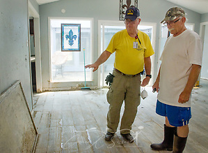 Southern Baptist Disaster Relief unit leader Brian Batchelder, of Broadview Baptist Church in Abilene, Texas; discusses cleanup efforts with homeowner Paul Matlock; Sept. 6, 2017, in Houston, Texas. Matlock's home was inundated with more than six feet of water when Hurricane Harvey dumped more than 51 inches of rainfall in mid-August. Approximately 70 people died in the U.S. due to the hurricane and flooding, but that number is expected to rise as water levels fall, allowing rescuers to reach more areas. (Photo by Carmen K. Sisson (Carmen K. Sisson/Cloudybright)