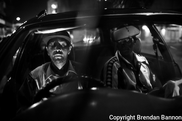 Taxi Driver Walter Njau (L) and car wash man John Mgogo in Nairobi. (Brendan Bannon)