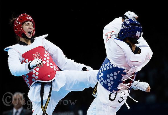 10 AUG 2012 - LONDON, GBR - Sarah Stevenson (GBR) (left) of Great Britain aims a kick at Paige McPherson of the USA during their women's -67kg category contest London 2012 Olympic Games Taekwondo at Excel in London, Great Britain .(PHOTO (C) 2012 NIGEL FARROW) (NIGEL FARROW/(C) 2012 NIGEL FARROW)