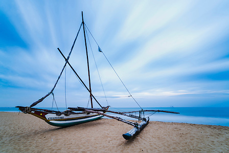 Outrigger fishing boat, Negombo Beach, Sri Lanka, Asia. This is a photo of an outrigger fishing boat (known locally as Oruva) on Negombo Beach in Sri Lanka, Asia.
