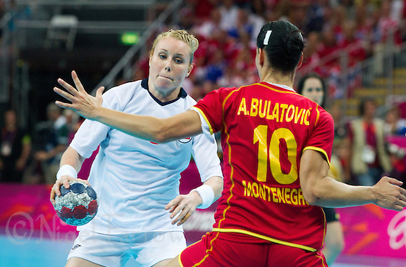 11 AUG 2012 - LONDON, GBR - Karoline Dyhre Breivang (NOR) (left) of Norway looks for a way past Andjela Bulatovic (MNE) (right) of Montenegro during the women's London 2012 Olympic Games handball final at the Basketball Arena in the Olympic Park, in Stratford, London, Great Britain(PHOTO (C) 2012 NIGEL FARROW) (NIGEL FARROW/(C) 2012 NIGEL FARROW)