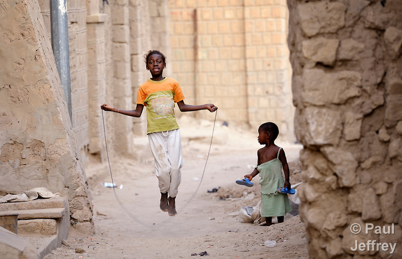 A girl jumps rope in a street in Timbuktu, the northern Mali city that was seized by Islamist fighters in 2012 and then liberated by French and Malian soldiers in early 2013. During the jihadis' rule, girls and women could not appear in public unless they were completely covered. (Paul Jeffrey)