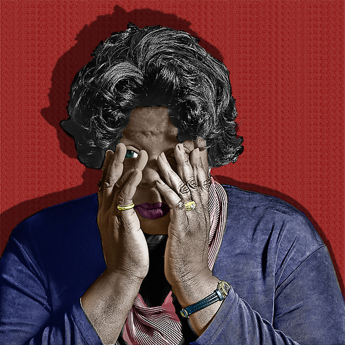 In this powerful image, we see an older black woman with her hands over her face. She is trying to cover them up, but we can see a single eye peering out at us from behind her weary hands. This is a powerful reminder of the way we close our eyes to racism. Some of us look with only one eye, hidden behind our trembling hands. This black and white with color piece reminds us that it is not simply enough to look with a partial gaze. We must stare back at racism with both eyes. (Jan Keteleer)