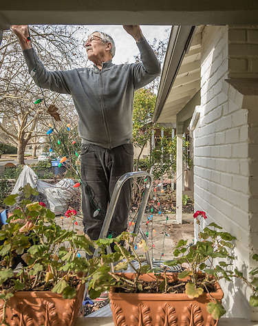 """it is the absolute end of the holidays."" -Neighbor Michael Bode removes lights from his home on Cedar Street in Calistoga (Clark James Mishler)"