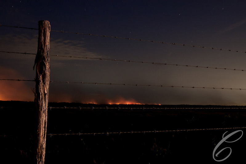 Smoke and flame from the Dyer fire lights up the the  Grimes County, Texas horizon  east of Whitehall on June 20, 2011. (Matthew Crawley)