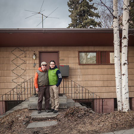 Glen Hemingson (orange) and Ricardo Lopez in front of their house on Fifth Avenue near Elderberry Park in Anchorage.  glen@copperwhale.com (© Clark James Mishler)