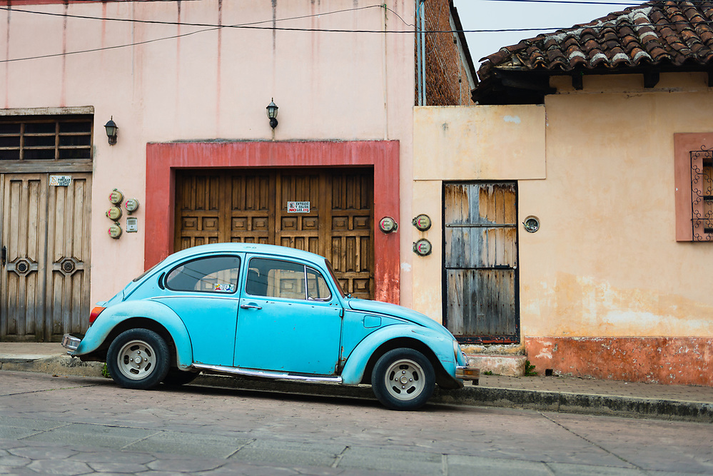 Old car in front of Spanish colonial building in San Christobal, Mexico (Mark Eden)