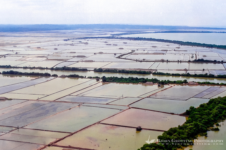 Java, East Java, Madura. The large fields for extraction of salt from sea water cover large areas of southern Madura (from helicopter). (Photo Bjorn Grotting)