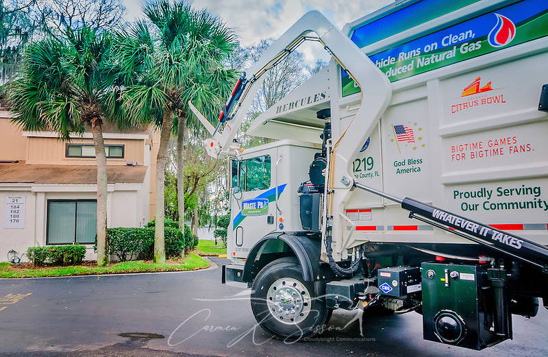 "A Waste Pro Mack Titan collects garbage in the La Vista community, March 18, 2016, in Sanford, Florida. Waste Pro offers waste and recycling services to more than two million residential customers and more than 40,000 businesses in Alabama, Florida, Georgia, South and North Carolina, Louisiana, Mississippi, and Tennessee. The company has committed to ""going green"" by implementing a number of green initiatives, including using CNG (Clean Natural Gas) in its trucks, recycling more waste instead of sending it to landfills, and powering its regional headquarters through solar energy. (Photo by Carmen K. Sisson/Cloudybright) (Carmen K. Sisson/Cloudybright)"