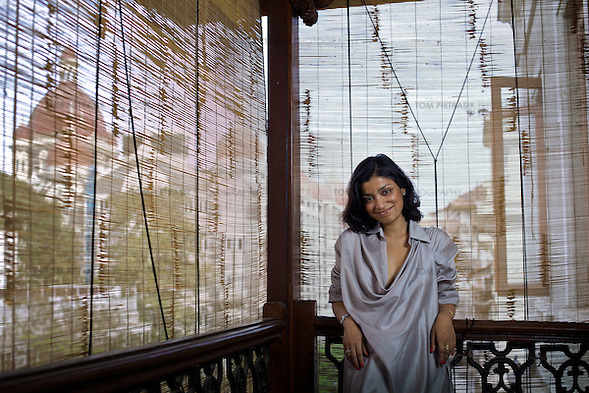 Designer Divya Thakur with a view of the Taj Hotel from the veranda of her recently renovated home on the fourth floor of a century-old building in the Colaba neighbourhood of Mumbai. Thakur runs Design Temple, a graphics firm that she established ten years ago...Photo: Tom Pietrasik.Mumbai, India.February 2010 (Tom Pietrasik)