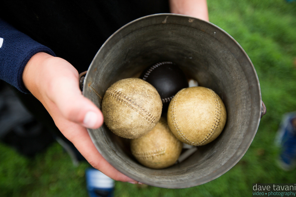 """Liam Kelly from the Potter Pirates holds a pale of """"orange peel"""" style baseballs. (Dave Tavani)"""