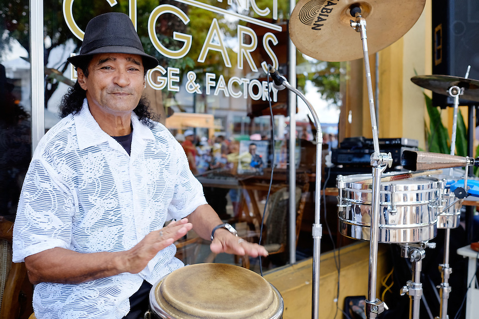 MIAMI - MARCH 9, 2014: Portrait of musician with drums during the 37th Calle Ocho festival, an annual event that takes place over Eighth Street in Little Havana featuring plenty of music, food, and  it is the biggest party in town that celebrates hispanic heritage. (Daniel Korzeniewski)