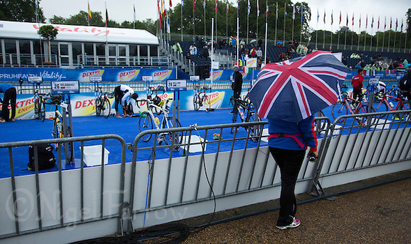 12 SEP 2013 - LONDON, GBR - A spectator waits by transition for the start of the junior men's ITU 2013 World Triathlon Championships in Hyde Park in London, Great Britain (PHOTO COPYRIGHT © 2013 NIGEL FARROW, ALL RIGHTS RESERVED) (NIGEL FARROW/COPYRIGHT © 2013 NIGEL FARROW : www.nigelfarrow.com)