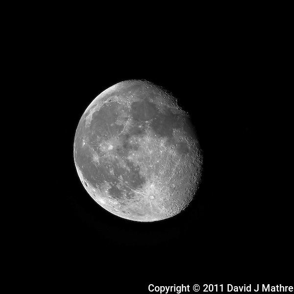 Waining Gibbous Moon over New Jersey. Image taken with a Nikon D3x and 500 mm f/4 VR telephoto lens (ISO 100, 500 mm, f/4, 1/160 sec). Raw image processed with Capture One Pro 6, Focus Magic, and Photoshop CS5. (David J Mathre)