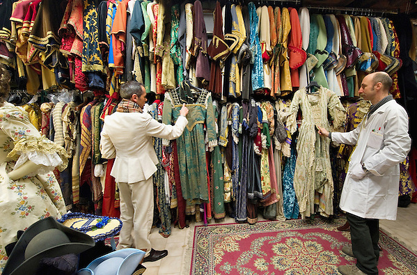 VENICE, ITALY - JANUARY 20:  Choreographer Raffaele Dessi (L) and tailor Francesco Briggi (R) of the historic atelier Pietro Longi check few costumes on January 20, 2012 in Venice, Italy. This is one of the busiest periods of the year for the atelier as the next few weeks the streets and canals of Venice will be filled with people attending the carnival,  wearing highly-decorative and imaginative carnival costumes and masks. (Marco Secchi)