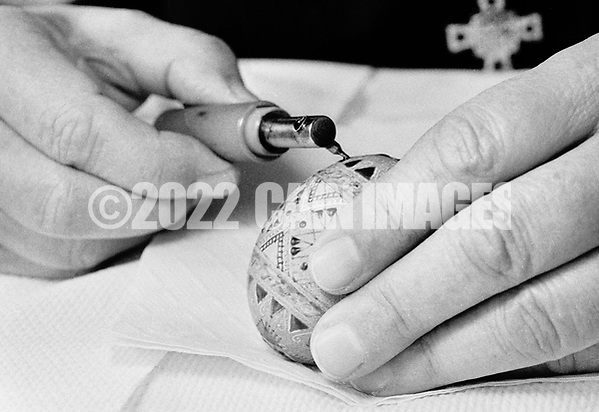 Sister Josaphat Slobodian draws a pattern on an egg while doing Ukrainian egg decorating, or pysanky, Tuesday, May 01, 1990 at Sisters of Saint Basil The Great motherhouse in Glenside, Pennsylvania. (Photo by William Thomas Cain/Cain Images) (William Thomas Cain/Cain Images)