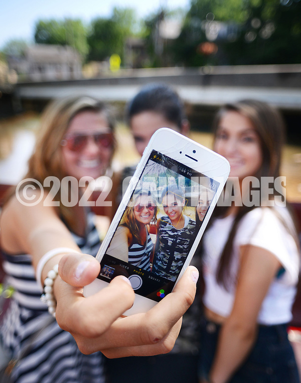 NEW HOPE, PA - JUNE 02:  From left, Allie Becker, 19, Lauren Fitzpatrick, 18 and Capri Wagner, 18 all of Newtown, Pennsylvania are seen through an iPhone monitor as they make a selfie near the Bucks County Theater on a warm afternoon June 2, 2014 in New Hope, Pennsylvania.  The temperature reached 82 degrees in New Hope and is expected to remain in the mid-80's for the next few days. (Photo by William Thomas Cain/Cain Images) (William Thomas Cain)
