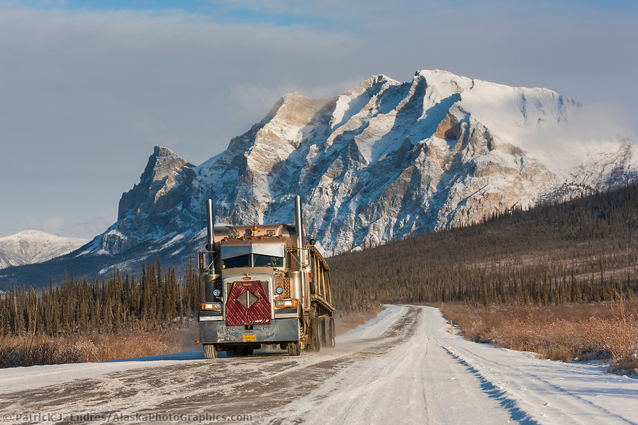 Trucking photos: Semi tractor trailer travels the James Dalton Highway (the haul road) with mt Sukakpak rising in the distance. (Patrick J Endres / AlaskaPhotoGraphics.com)