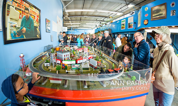 Farmingdale, New York, USA. November 26, 2016. At TMB Train Masters of Babylong Model Train Club's Open House, visitors look at actual train display - complete with blood stains - seen in'The Blue Comet' episode of'The Sopranos'. Photo above layout is scene with character Bobby Baccalieri at L.I. model train store. (Ann Parry/Ann Parry, ann-parry.com)