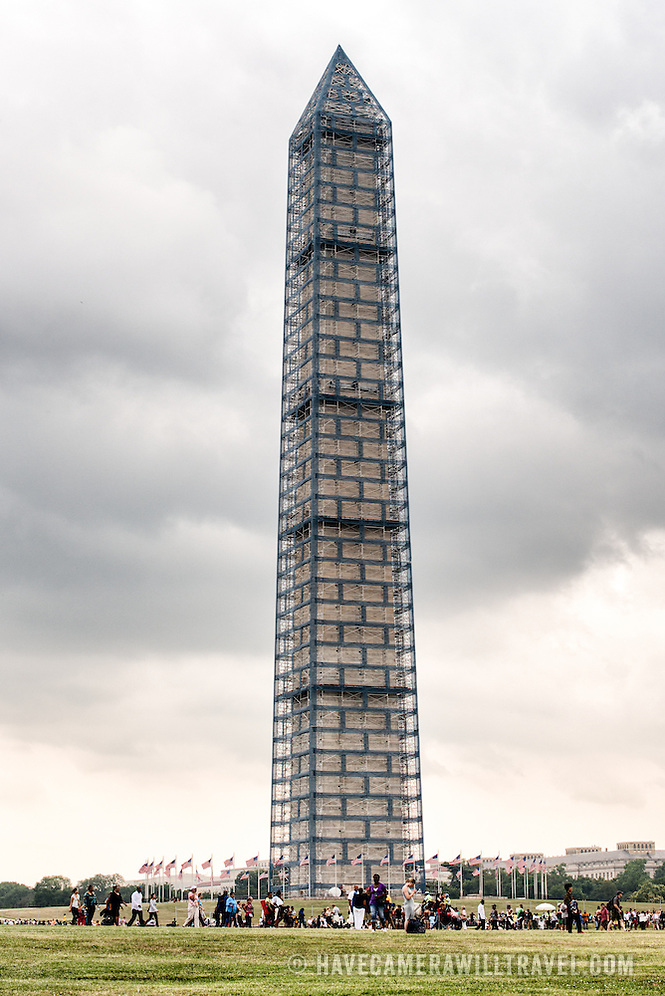 Scaffolding encases the Washington Monument as the landmark undergoes structural repairs caused by an earthquake. (David Coleman / havecamerawilltravel.com)