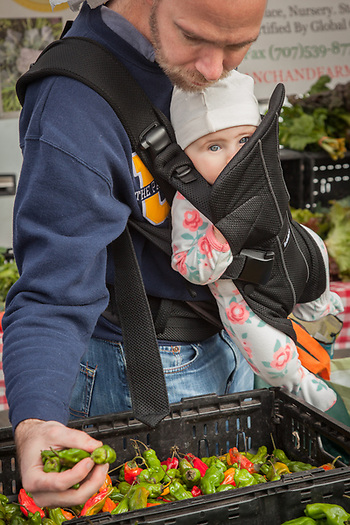 Eight month old Rose watches on as her father, Doug, selects peppers at the Saturday Market in Calistoga, CA  dca2203@hotmail.com (© Clark James Mishler)