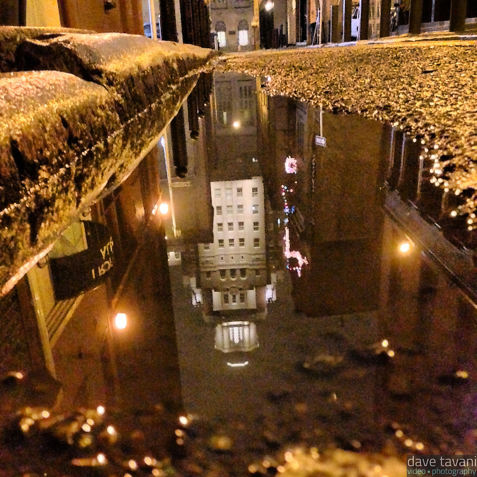 The U.S. Customs House reflects in a puddle on Strawberry Street in the Old City section of Philadelphia on December 16, 2012. (Dave Tavani)