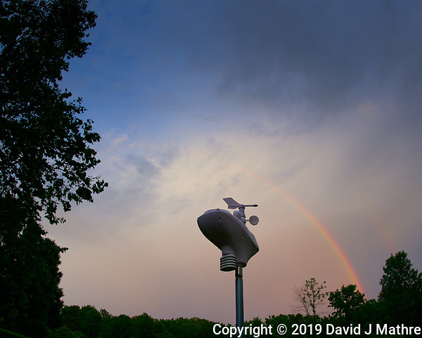 Backyard Evening Rainbow over the Weather Station. After the Thunderstorm. Image taken with a Nikon D810a camera and 8-15 mm fisheye lens (ISO 200, 15 mm, f/7.1, 1/200 sec). Raw image processed with Capture One Pro. (DAVID J MATHRE)