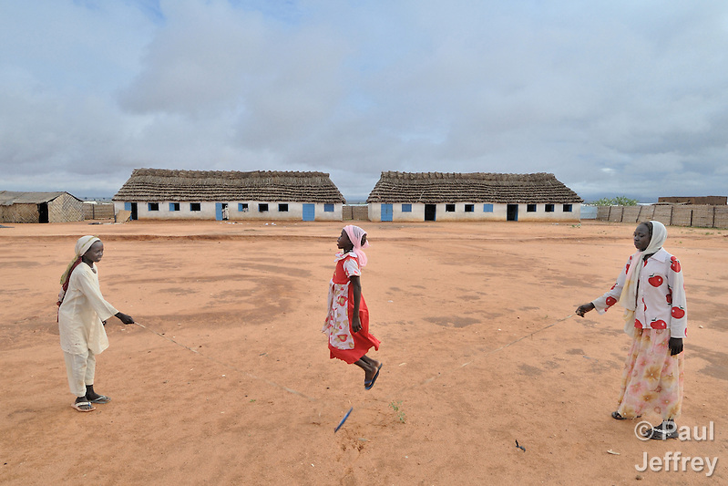 Girls skip rope in front of their school in the Dereig Camp for internally displaced persons. (Paul Jeffrey)