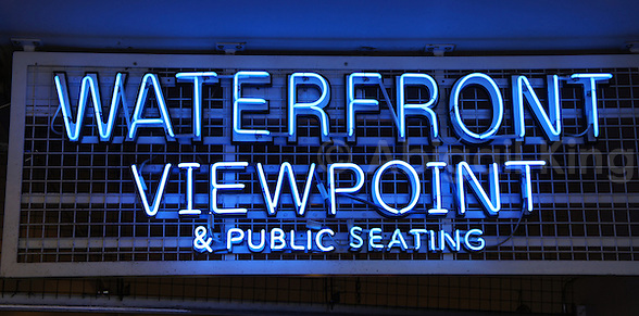Blue letters waterfront viewpoint & public seating sign
