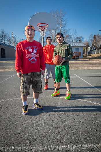 Roy Villahermosa (L), Rick Villahermosa (ball), and Leo Andres Jr. (back) during a shoot around at Inlet View Elementary School, Anchorage  rick_villahermosa@yahoo.com (© Clark James Mishler)