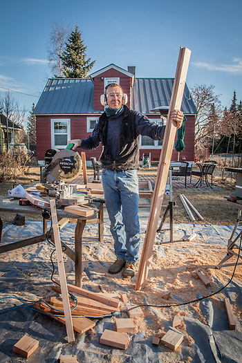 "Neighbor Jan-Ake Schultz in his yard.  ""I'm building nine beds for my six cabins on Kenai Lake…I never imagined it would take so much time.""  jaischultz2@yahoo.com (© Clark James Mishler)"