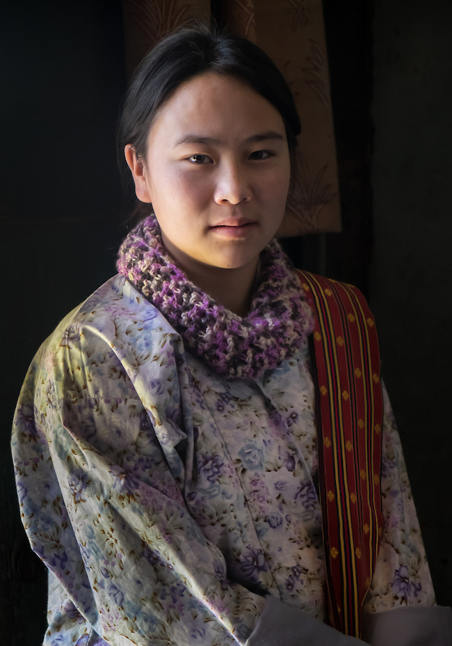 PARO, BHUTAN - CIRCA OCTOBER 2014: Portrait of young Bhutanese woman looking at camera in Bhutan (Daniel Korzeniewski)