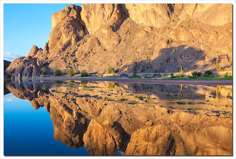 Mountain with reflections in a river, Fint Oasis, Ouarzazate, Morocco. (Rosa Frei)