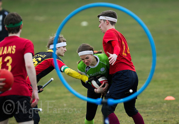 08 MAR 2015 - NOTTINGHAM, GBR - Hannah Watts from Keele Squirrels tries to force her way through to goal during the 2015 British Quidditch Cup match against Reading Rocs at Woollaton Hall and Deer Park in Nottingham, Great Britain (PHOTO COPYRIGHT © 2015 NIGEL FARROW, ALL RIGHTS RESERVED) (NIGEL FARROW/COPYRIGHT © 2015 NIGEL FARROW : www.nigelfarrow.com)