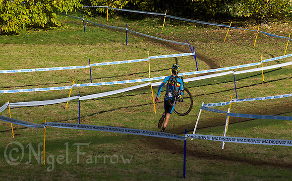 03 NOV 2012 - IPSWICH, GBR - Ben Boets (BEL) of Belgium carries his bike back to the pits during the Junior Men's European Cyclo-Cross Championships in Chantry Park, Ipswich, Suffolk, Great Britain (PHOTO (C) 2012 NIGEL FARROW) (NIGEL FARROW/(C) 2012 NIGEL FARROW)