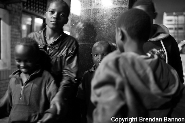 Sisters Christine Muthoni, 9, and Mary Njeri,14, beg on the streets of Westlands at night with other children in Naiorbi. (Brendan Bannon)