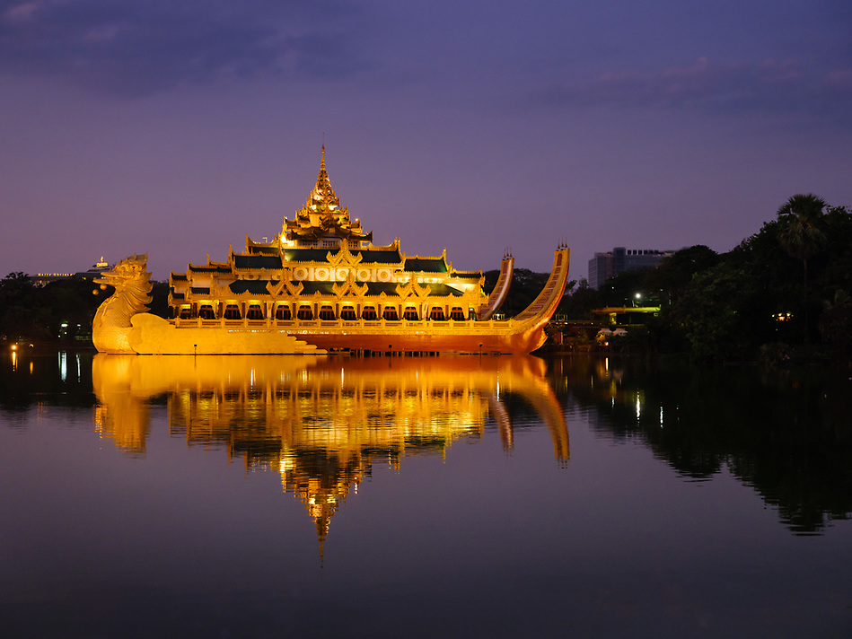 YANGON, MYANMAR - CIRCA DECEMBER 2017: View of the Karaweik Hall at Kandawgyi Lake in Yangon. (Daniel Korzeniewski)