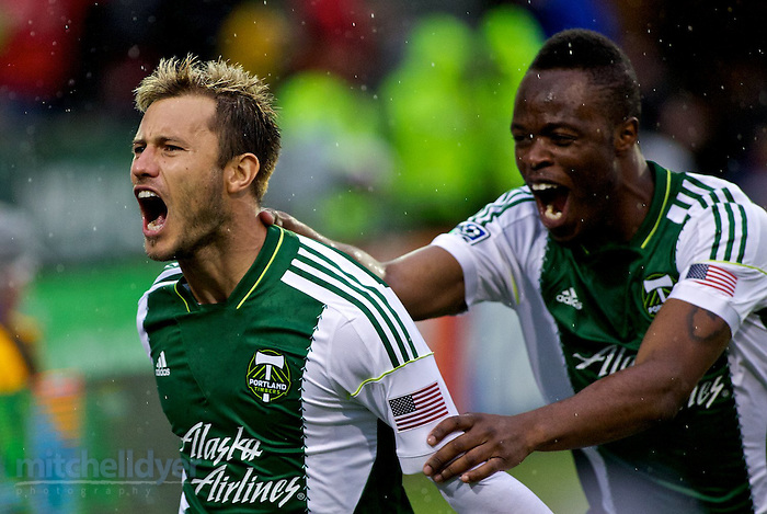 May 3, 2014; Portland, OR, USA; Portland Timbers forward Gaston Fernandez (10) and midfielder Steve Zakuani (7) celebrate the first goal of the match during the first half at Providence Park. Photo: Craig Mitchelldyer-Portland Timbers (Craig Mitchelldyer)