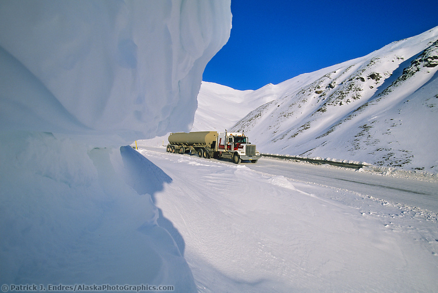Trucking photos: Semi tractor trailer travels down north side of Atigun Pass, James Dalton Highway, Brooks Range, Alaska (Patrick J. Endres / AlaskaPhotoGraphics.com)
