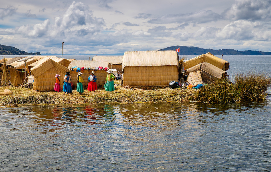 UROS ISLANDS, PERU - CIRCA APRIL 2014: Women from the Uros Islands in Lake Titicaca waiting for tourists to arrive. (Daniel Korzeniewski)