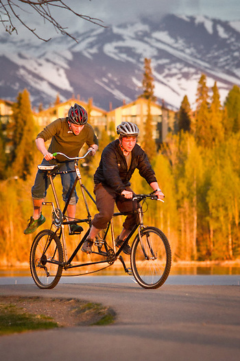 David Hansen and his brother, Mark, test ride David's  experimental bicycle near Westchester Lagoon, Anchorage. (Clark James Mishler)