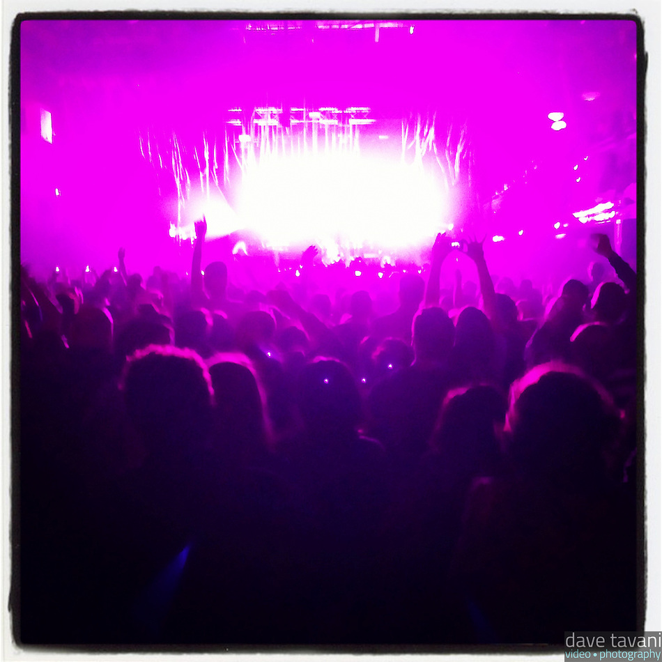 The stage lights at the Electric Factory cast a magenta light on the audience during Passion Pit's November 29, 2012 performance. (Dave Tavani)