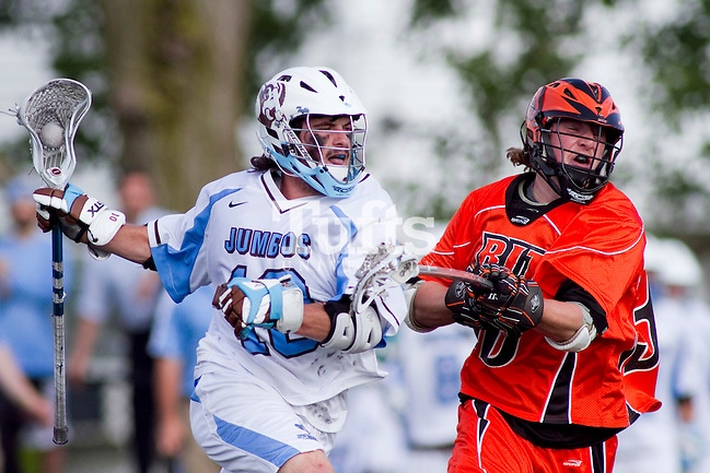 05/16/2012 - Medford, Mass. - Tufts midfielder Kevin McCormick (10), E12, powers through a check RIT long stick midfielder James Cunningham (30) in Tufts 15-13 win over RIT in the NCAA Championship quarterfinal at Bello Field on May 16, 2012.  (Kelvin Ma/Tufts University) (Kelvin Ma/Tufts University)