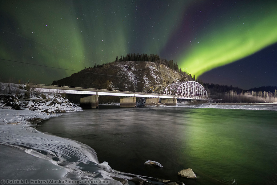 Northern lights over the Tanana river and the suspension bridge for the Trans Alaska Oil Pipeline in Delta Junction. (Patrick J Endres / AlaskaPhotoGraphics.com)